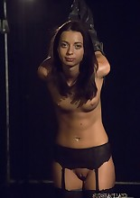 This pretty tanned body in black lingerie performs some dark rites, but only at the master's..