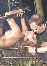 In the odd dark forest,the submissive Tina Hot is held in bondage, cruelly tied up and dominated..
